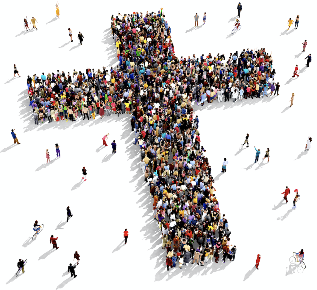 Arial view of people gathered together in a the shape of a cross.