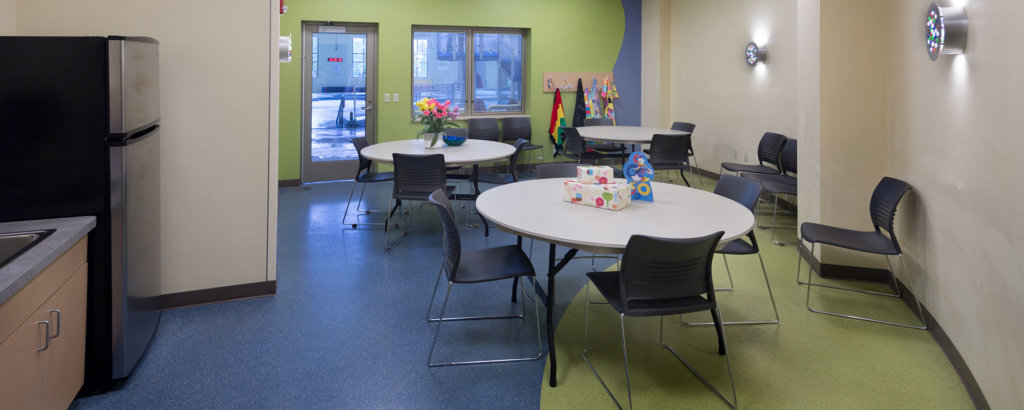 Birthday party room adjoining the pool, set up with tables and chairs.